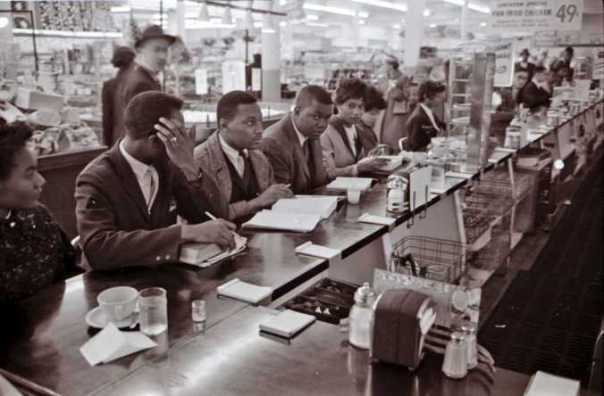 Human rights activists sitting for justice at a Woolworth's Lunch Counter, Greensboro 1960